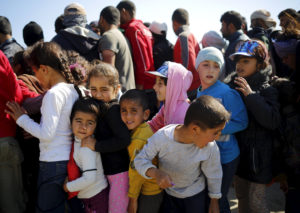 comment-eu-children-line-up-for-food-at-a-makeshift-camp-for-migrants-and-refugees-at-the-greek-macedonian-border-near-the-village-of-idomeni