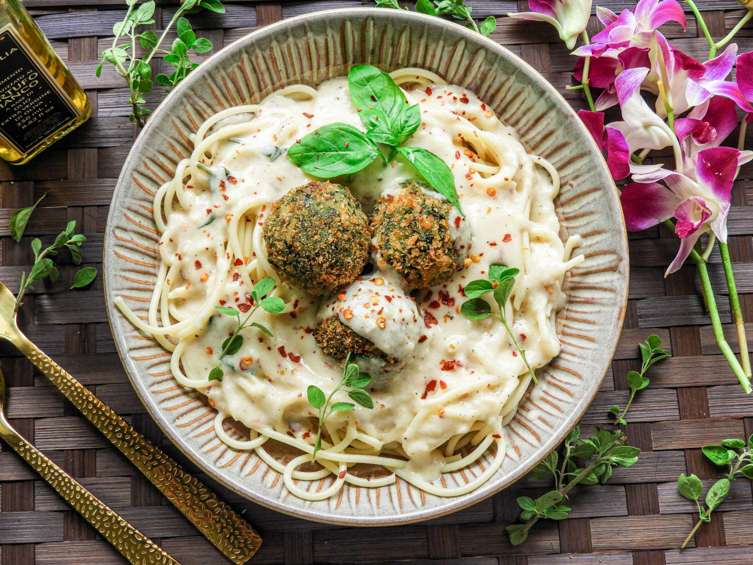 Spaghetti with Goat Cheese Spinach Balls & Cheese Sauce