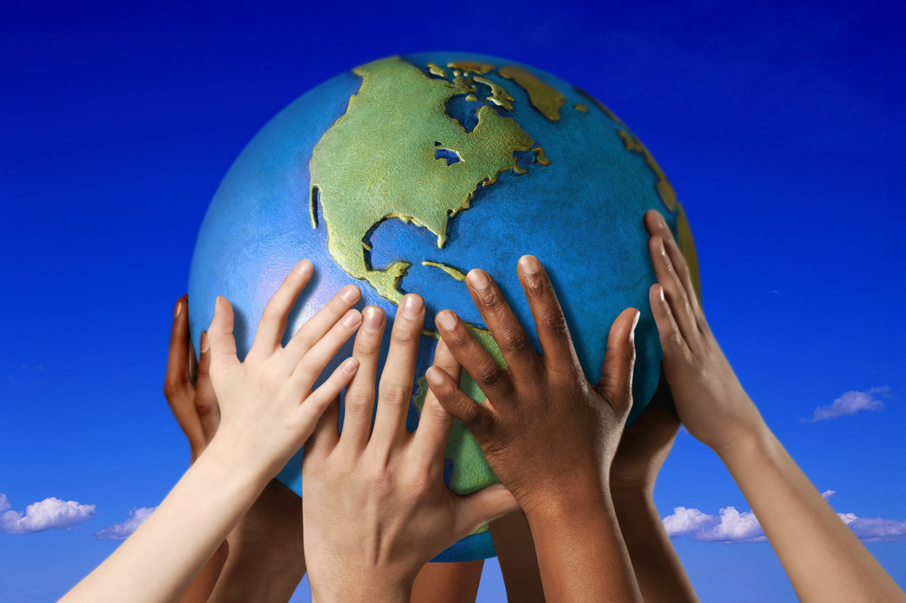Hands holding up and touching the world