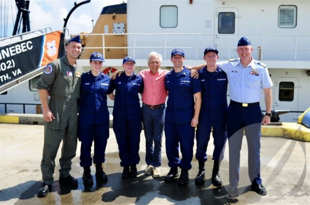 Shipwreck survivor Jacob Van Ommen (center) with rescuers (l-r) Coast Guard Petty Officer 3rd Class John Fuller, Petty Officer 2nd Class Brittany Wygand, Petty Officer 1st Class Andrea Cobb, Petty Officer 2nd Class Michael Luker, Lt. j.g. Bradley Milliken and Capt. Kevin Carroll. The group posed for this photo during an event on Coast Guard Base Portsmouth, Va., Aug. 16. Van Ommen met with the Coast Guard personnel who helped rescue him when his sailboat ran aground and sank near Myrtle Island, Virginia, June 23. ©(U.S. Coast Guard photo by Auxiliarist Trey Clifton/Released)