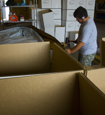 SpaCap Swim Spa Covers getting boxed up to ship out