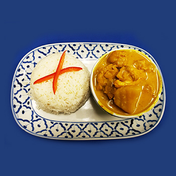 light yellow curry chicken with coconut milk and potatoes