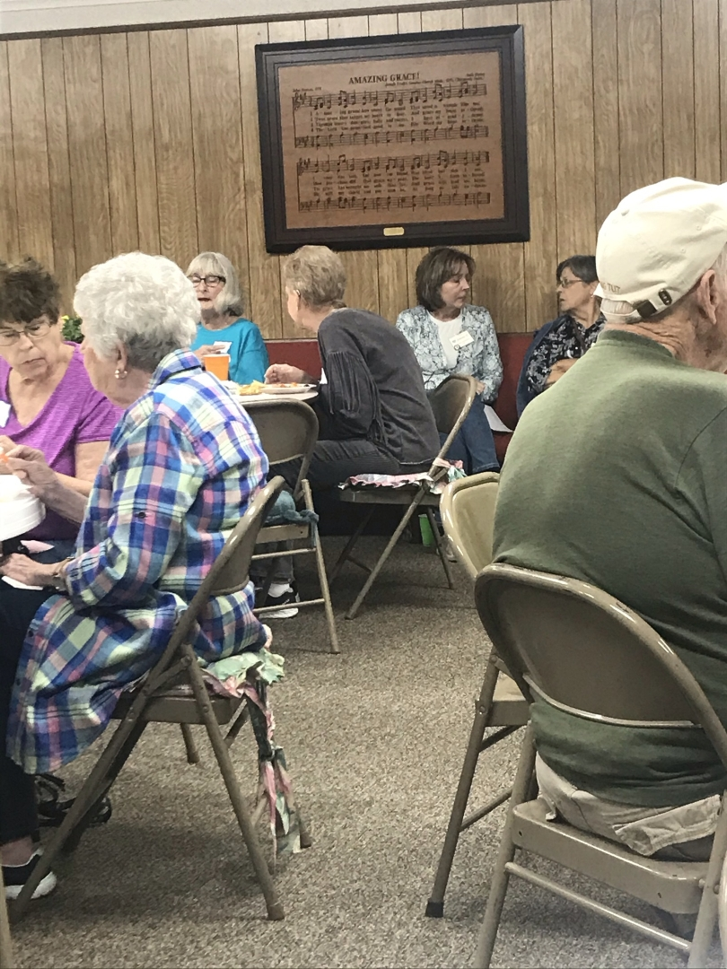 Senior Citizens Talking and Eating