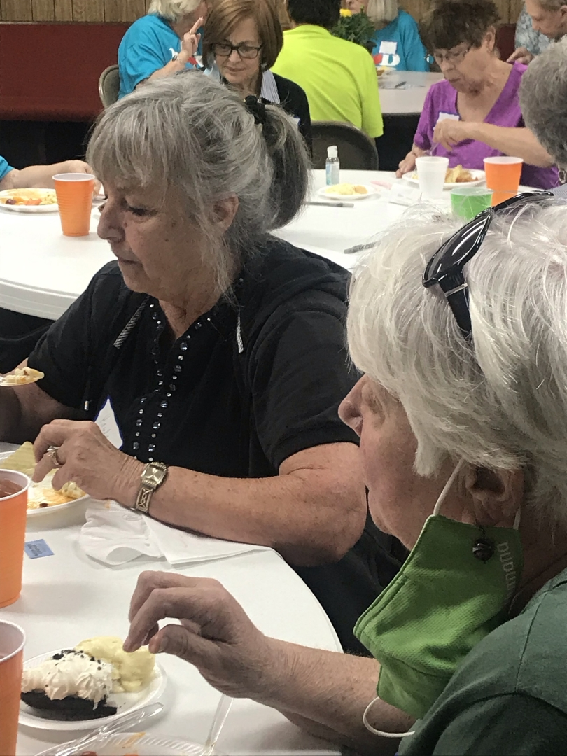 Old Women Eating and Talking