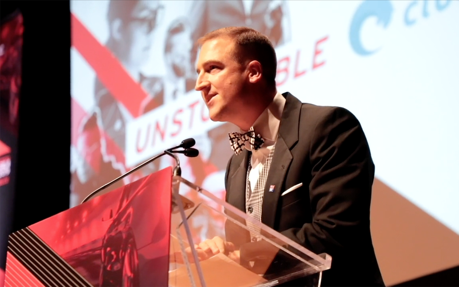 Photo of a person speaking from a podium at a CGLCC event.