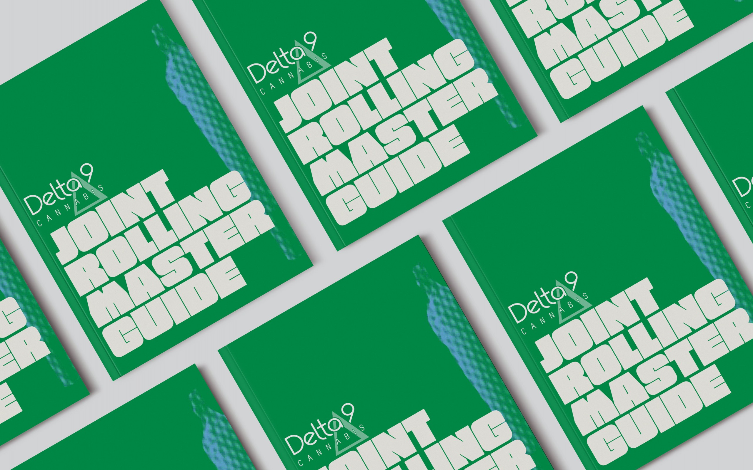 Several Delta9 Joint Rolling handbooks spread evenly across a white background.