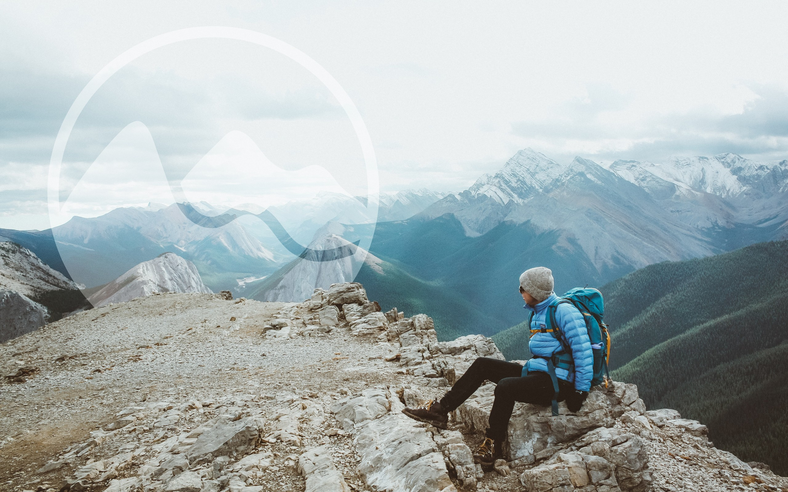 Hitchweb logo as a watermark on a photo of a hiker on a mountain.