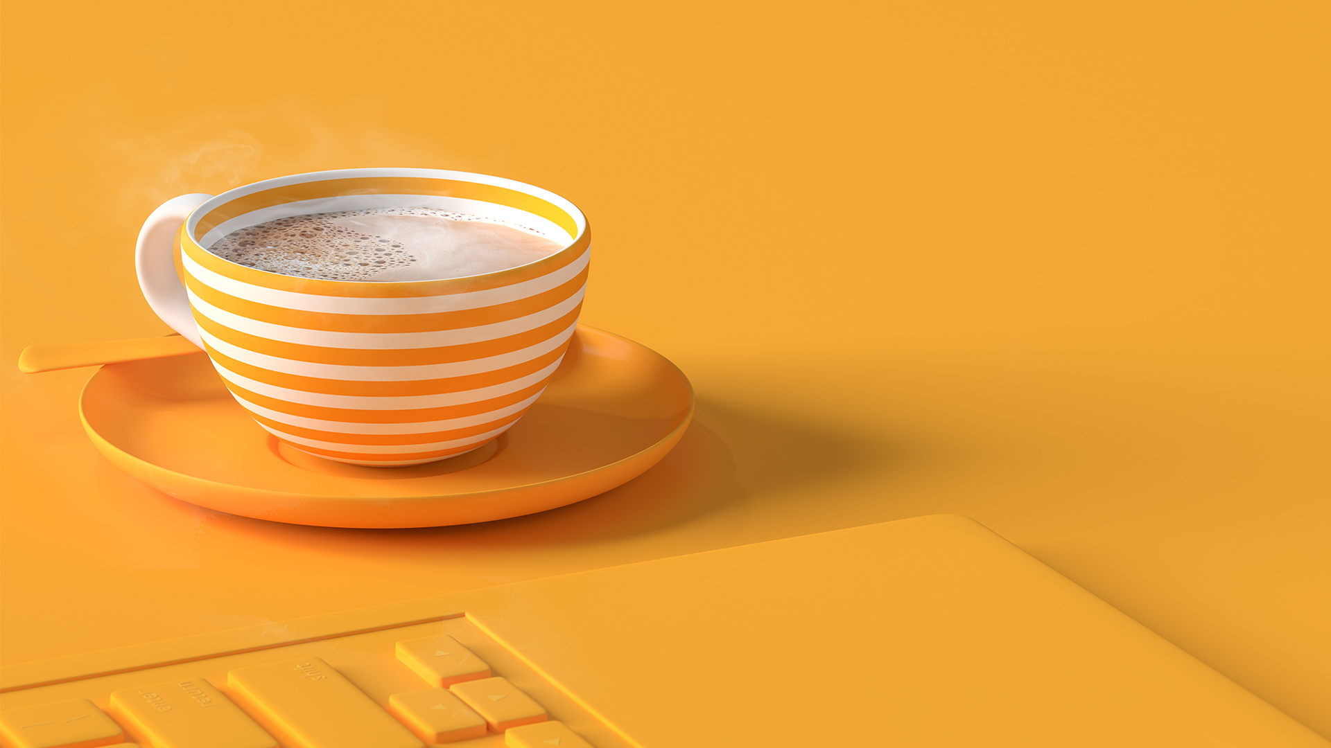 Yellow keyboard and white and yellow striped mug on saucer with steaming coffee
