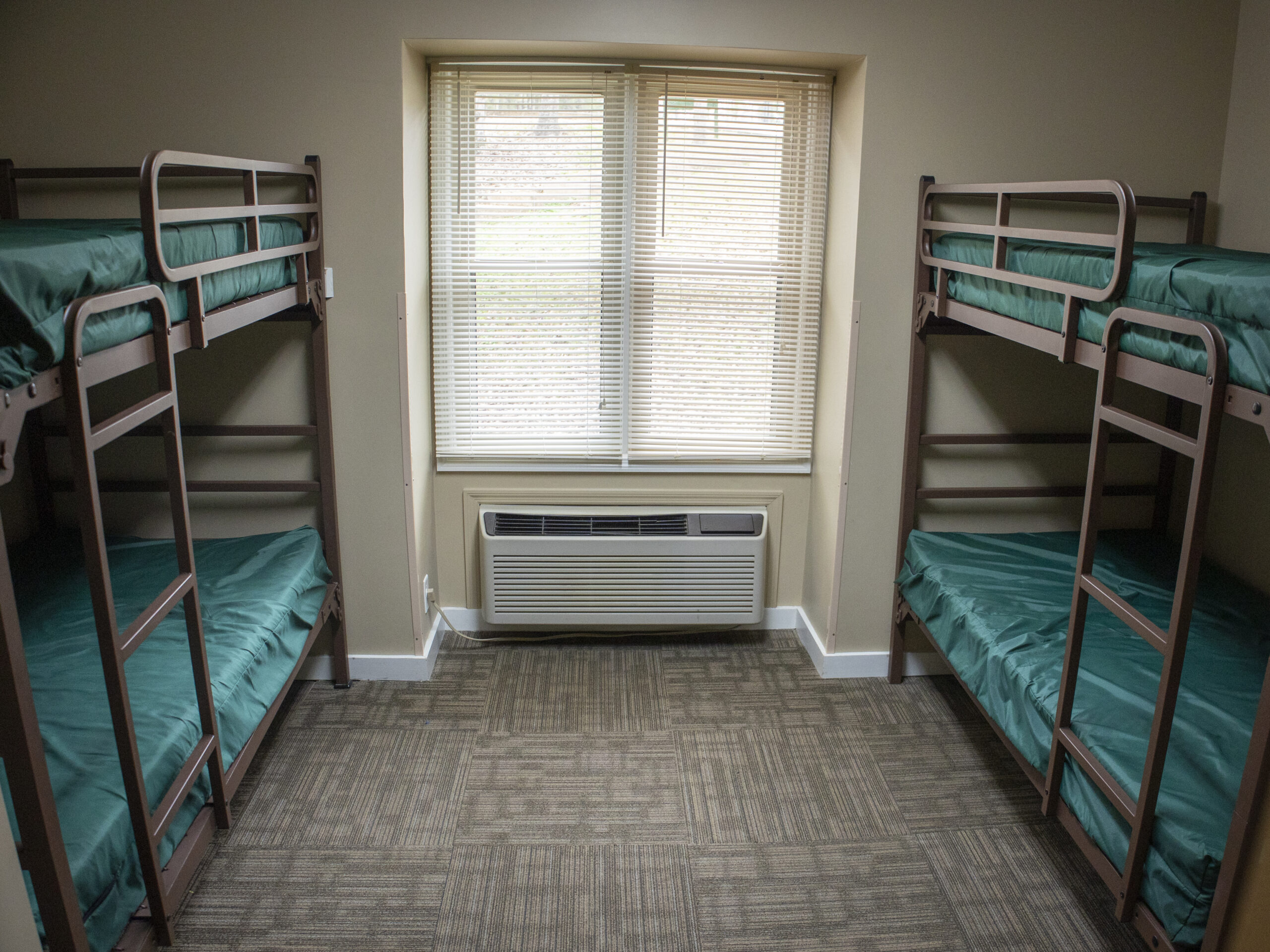 dorm room with two sets of bunk beds