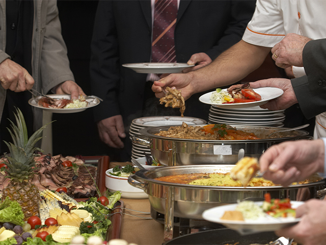 serving food on the buffet line