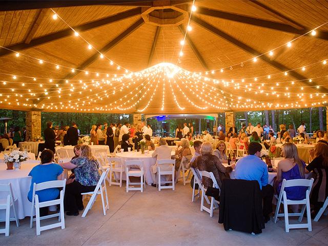 wedding reception at night in the pavillion