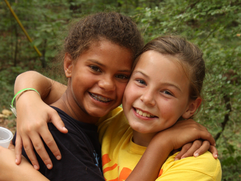 friends at camp hugging