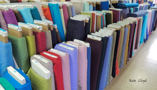 Amish women purchase easy-care, plain fabric at Zook's Fabrics in Intercourse, PA.