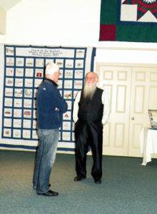 Steve Scott, standing on the right