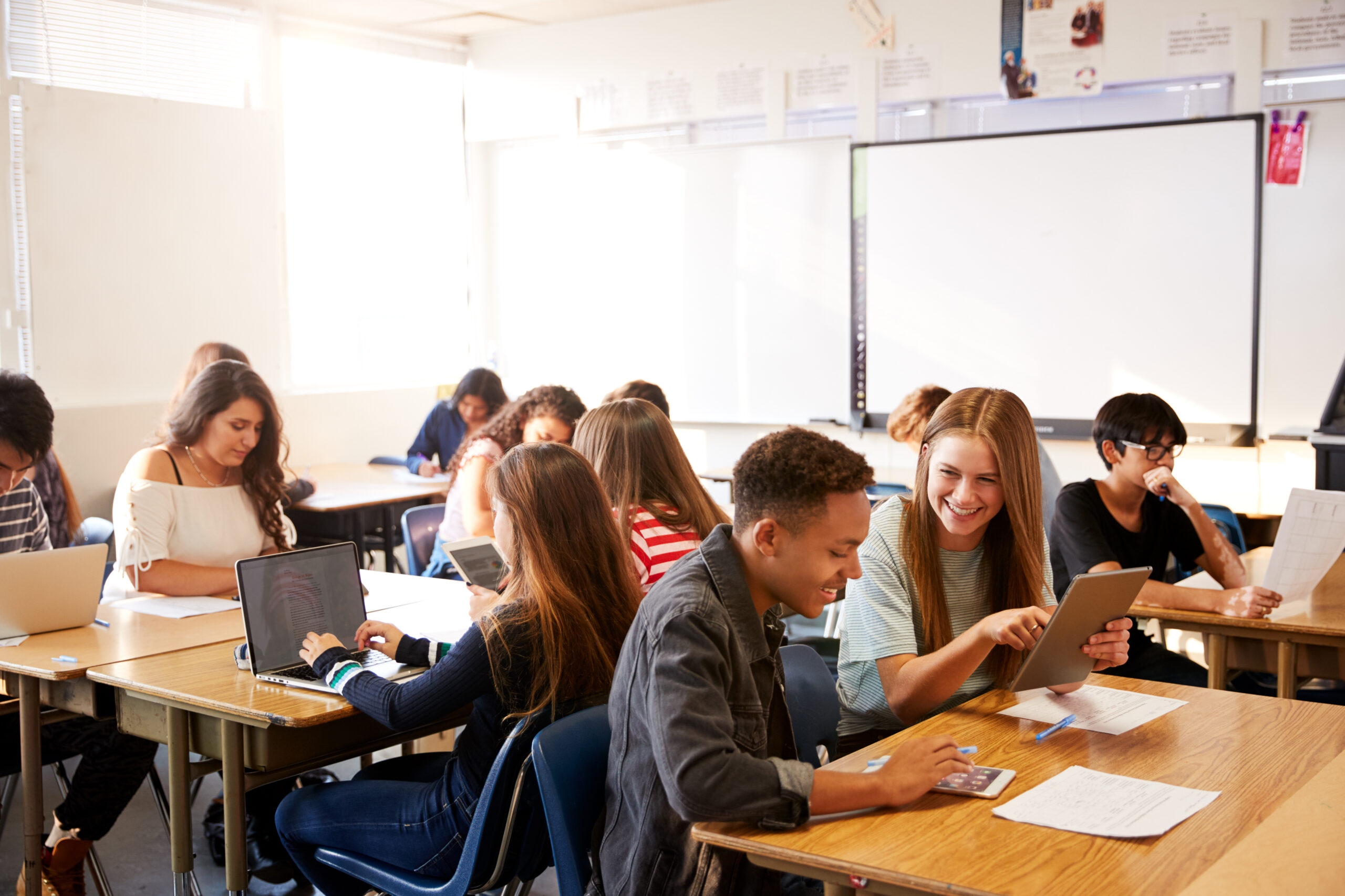Wide,Angle,View,Of,High,School,Students,Sitting,At,Desks