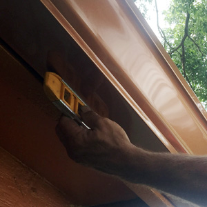 Making sure copper color gutters are level