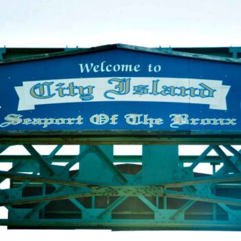 This is an image of a Welcome To City Island Sign