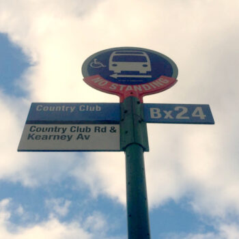 This is an image of a Country Club Bus Stop Sign
