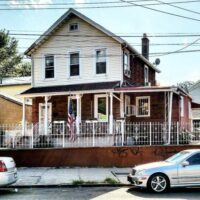 This is an image of a Corona House With American Flag
