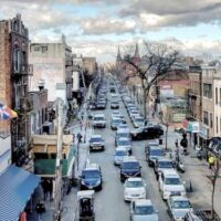 This is an image of a Corona Streetscape at 104th Street and Roosevelt Avenue