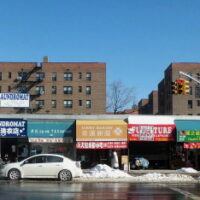 This is an image of Flushing Diner and Storefronts