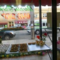 This is an image of the window of Morris Park Bake Shop