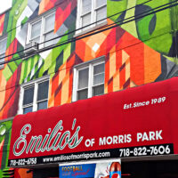This is an image of Morris Park Emilios Pizzeria With Colorful Mural