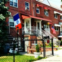 This is an image of Morris Park Homes With New York State and AmericanFlags