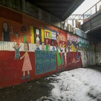This is an image of the Parkchester Viaduct Mural Depicing Bronx History