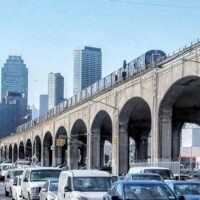 This is an image of Sunnyside With Elevated Train at Queens Blvd and 39th Place