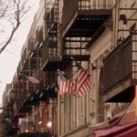 This is an image of Sunnyside building with American Flags