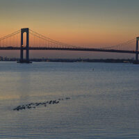 This is an image of Throgs Neck Bridge at dusk