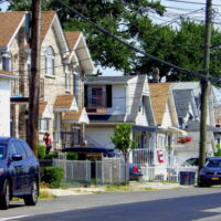 This is an image of Throggs Neck Houses with flags