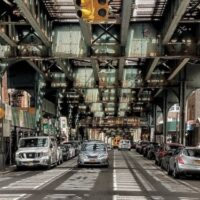 This is an image of Woodside Under the El
