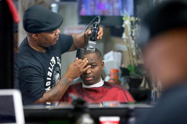 Billy Cabrera giving a haircut