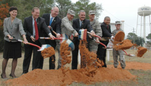 EGLIN AIR FORCE BASE, Fla. -- (Left to right) Trecia Chedister, Emerald Coast Fisher House founding member; Tom Rice, Emerald Coast Fisher House board member; David Coker. President of the Fisher House Foundation; Maj. Gen. David Eidsaune, Air Armament Center commander and the Air Force Program Executive Officer for Weapons; Congressman Jeff Miller; Col. Bruce McClintock, 96th Air Base Wing commander; Robin Baily, 96th Air Base Wing Director of Staff; and Col. Tama Van Decar, 96th Medical Group commander; shoveled the first bit of earth during the groundbreaking of the Emerald Coast Fisher House. There are currently 40 Fisher Houses worldwide. Fisher Houses provide a home-away-from-home for the families of servicemembers while loved ones are receiving medical treatment at military and Veteran Affairs facilities. (U.S. Air Force photo/Staff Sgt. Stacia Zachary)