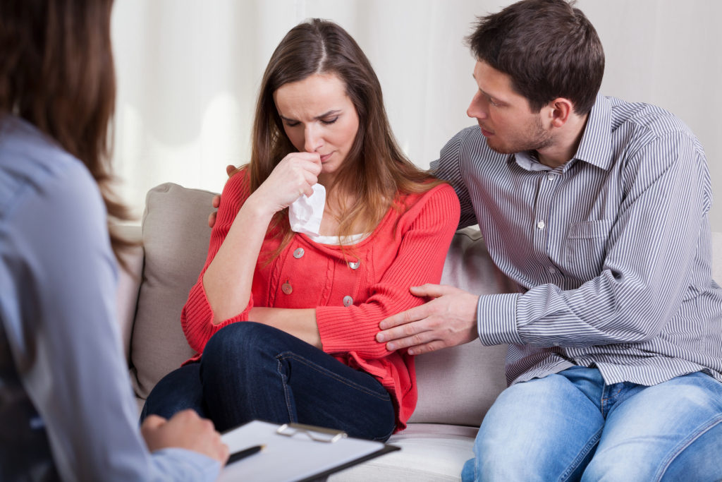 husband comforting wife