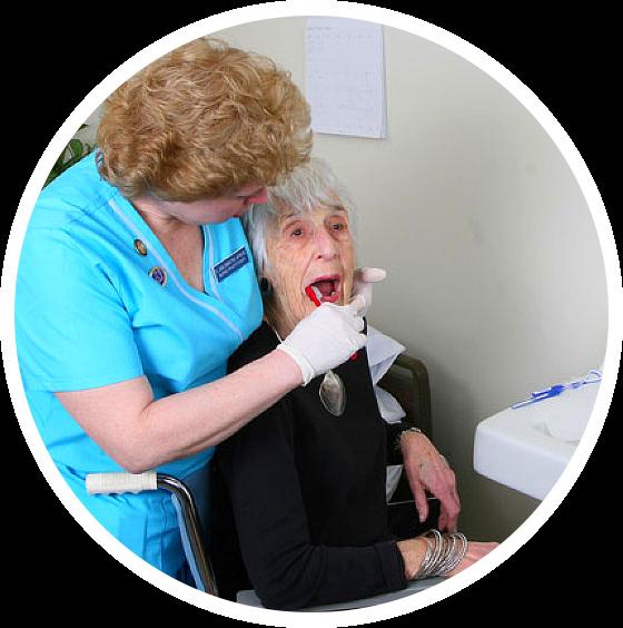 dentist brushing patient's teeth
