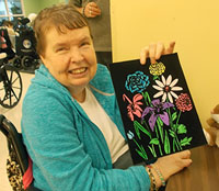 Cheerful Senior holding a painting