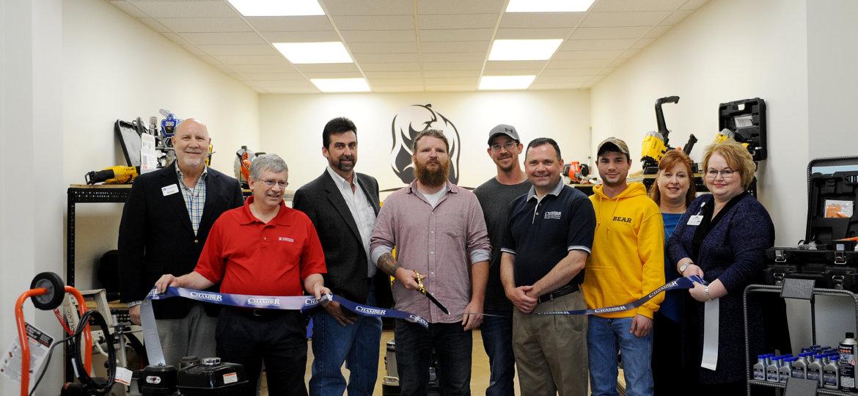 Bob Garrett, David Zartman, Tim Clark, Skyler Herb, Ryan Brezgel, Fred Gaffney, Cody Stine, Rep. Lynda Schlegel-Culver and Tea Jay Aikey cut the ribbon for Bear Rental.