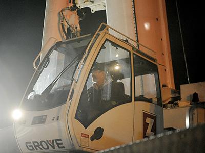A Zartman Construction crane operator works one of the team