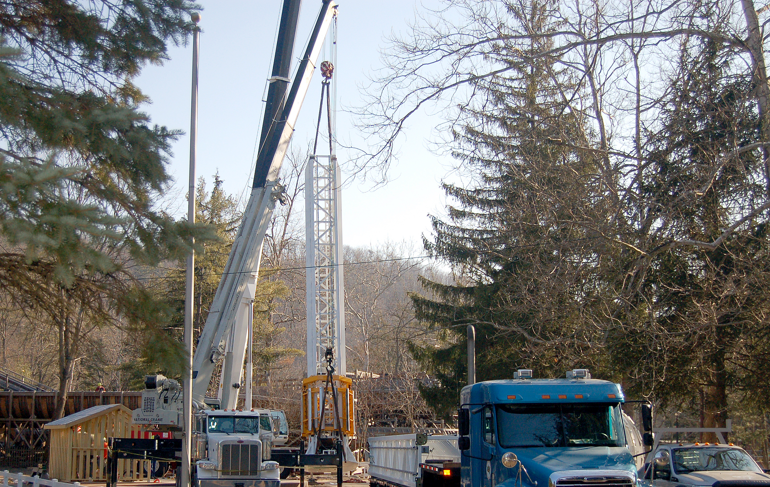 Part of the Stratos Fear is lifted off the trailer bed before being placed at Knoebels Amusement Resort.