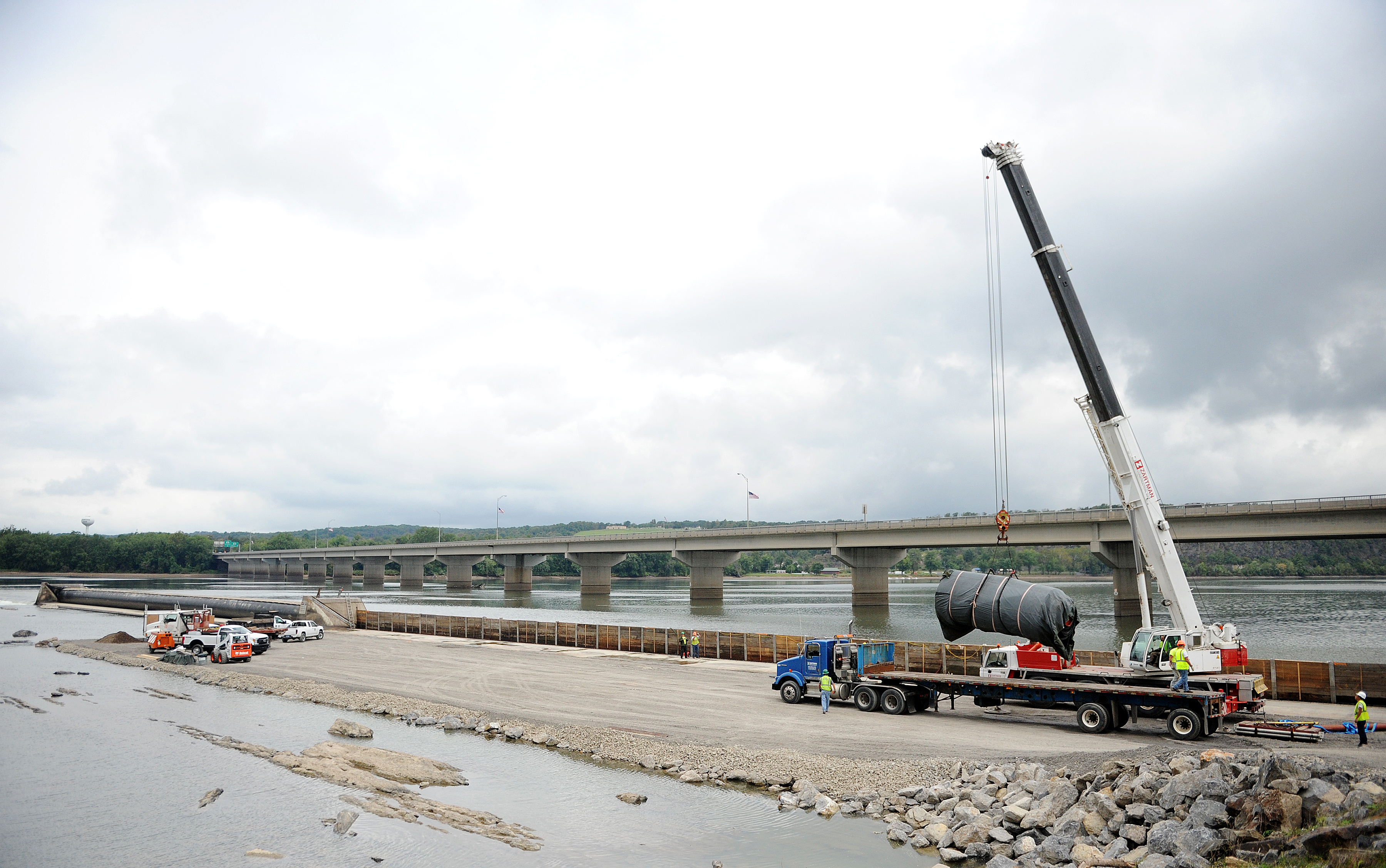 A section of the Adam T. Bower Dam is set into place after being repaired.