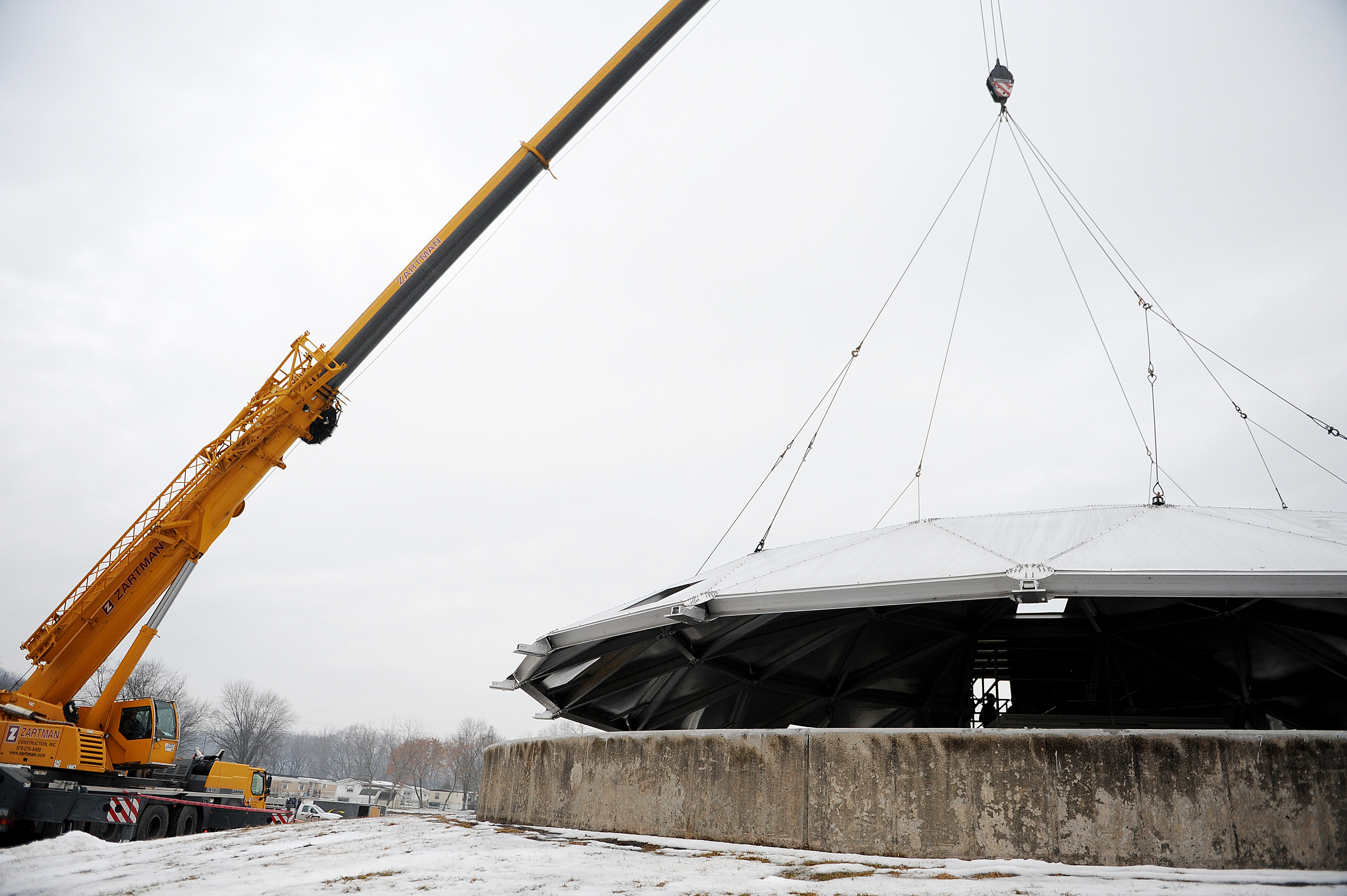 A Zartman Construction Inc. crane lowers the lid on to a clarifier at the Danville Water Treatment Plant.