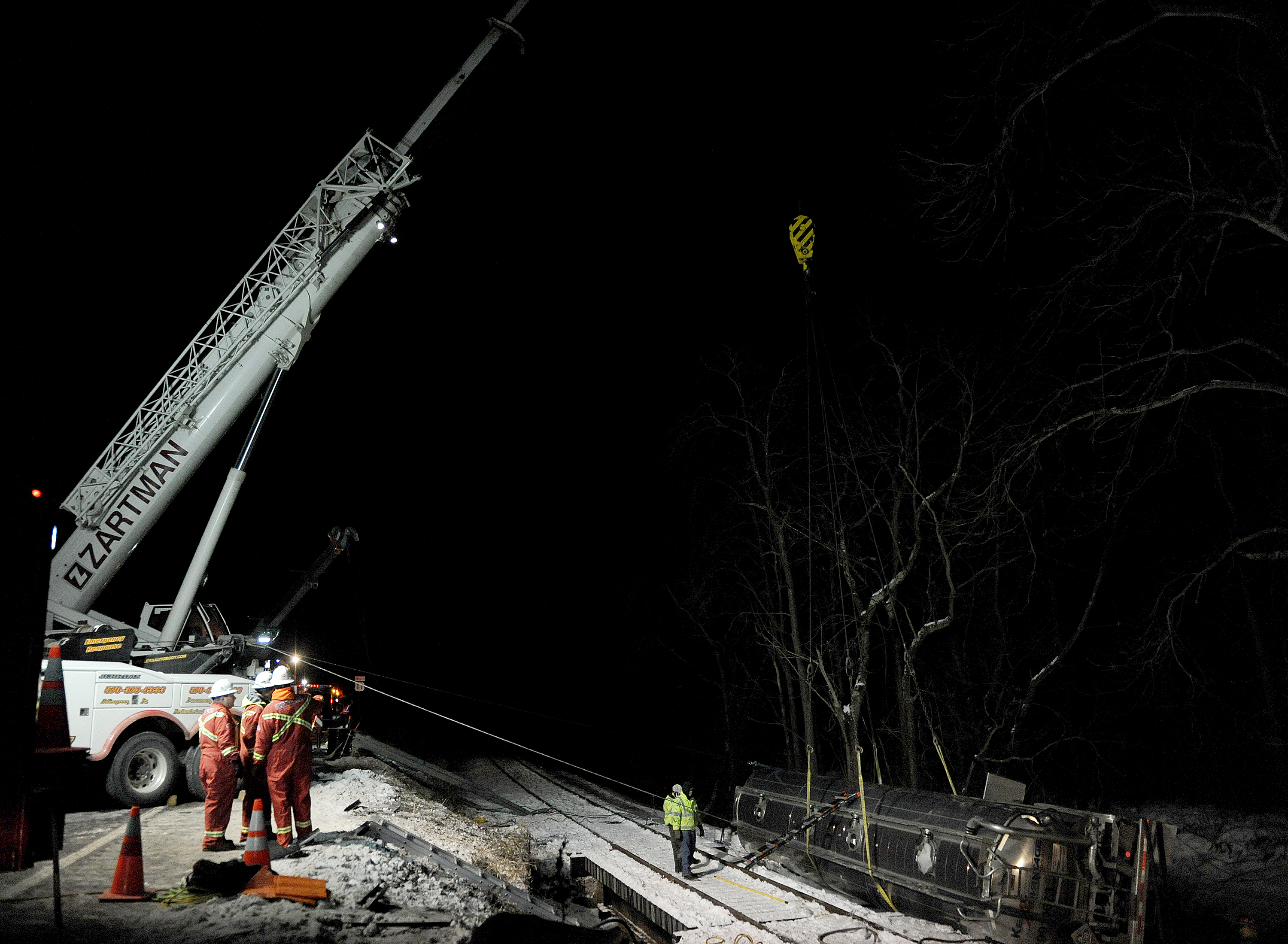 The 225 ton crane is used to stabilize an oil tanker after the tanker rolled off the highway.