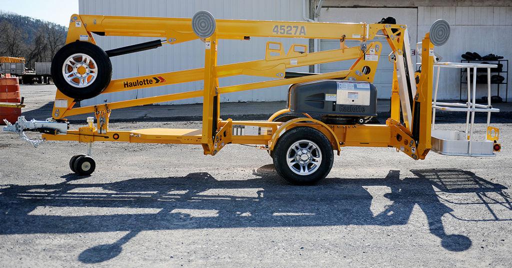 Haulotte tow-behind man lift rental