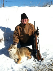 Stephen M. Vantassel with a coyote.