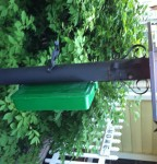 Raptor-357 Rodent Bait Station attached with magnets on a metal pole. Photo by Stephen M. Vantassel.