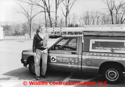 Stephen M. Vantassel next to his truck when he owned Wildlife Removal Service, Inc.