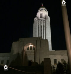 The Nebraska state capital building at night.